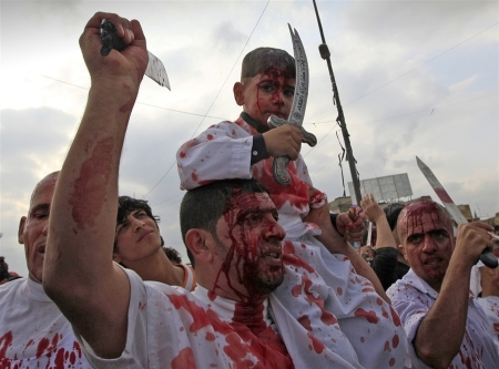 Msnbc.com : Thaier Al-sudani / Reuters Shiite Muslim worshippers, covered in their own blood from self-inflicted wounds, hold knives during a procession to mark the Muslim festival of Ashoura in Baghdad's Sadr City on Nov. 24